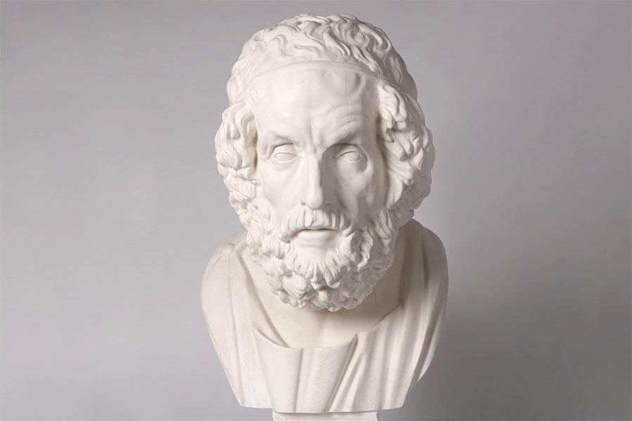 Zu sehen ist ein weißer Kunstmamorabguss des alten Homers.
